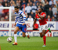 Jobi McAnuff of Reading (L) goes past Callum Harriott of Charlton Athletic (R) during the Sky Bet Championship match at The Valley, London<br /> Picture by Andrew Tobin/Focus Images Ltd +44 7710 761829<br /> 05/04/2014