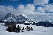 A snowy view of Sassolungo and Sassopiato Mountains behind the Alpe di Siusi ski area in the Dolomites near the village of Ortisei in the Dolomites, Italy