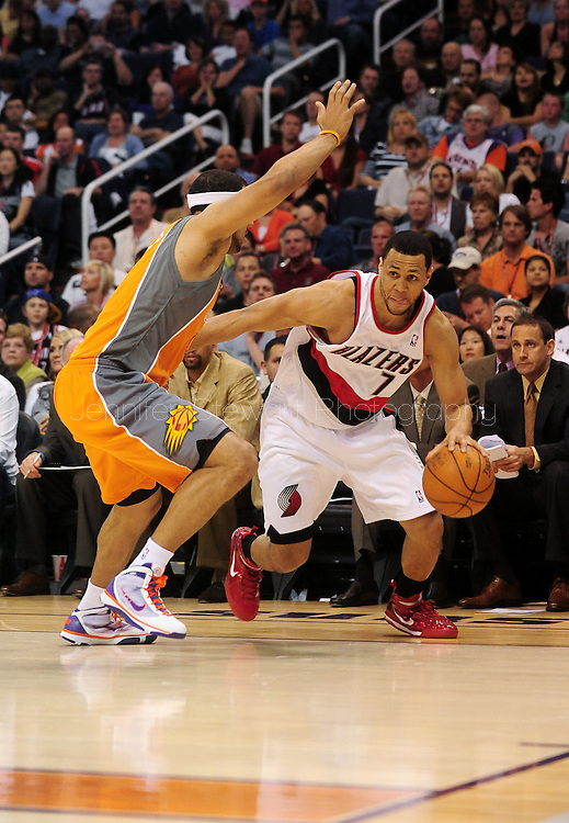 Mar. 21 2010; Phoenix, AZ, USA; Portland Trailblazers guard Brandon Roy (7) drives the ball against Phoenix Suns forward Jared Dudley (3) in the first half at the US Airways Center.   Mandatory Credit: Jennifer Stewart-US PRESSWIRE.