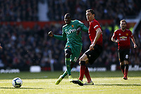 Football - 2018 / 2019 Premier League - Manchester United vs. Watford<br /> <br /> Abdoulaye Doucoure of Watford knocks a pass past Nemanja Matic, at Old Trafford.<br /> <br /> COLORSPORT/ALAN MARTIN