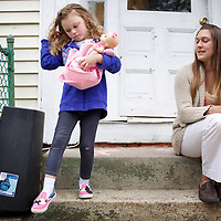 Julia with her daughter Annabella, age 5, on the doorstep of their home. Julia's apartment was provided with the assistance of the Supportive Housing program in Connecticut. <br />