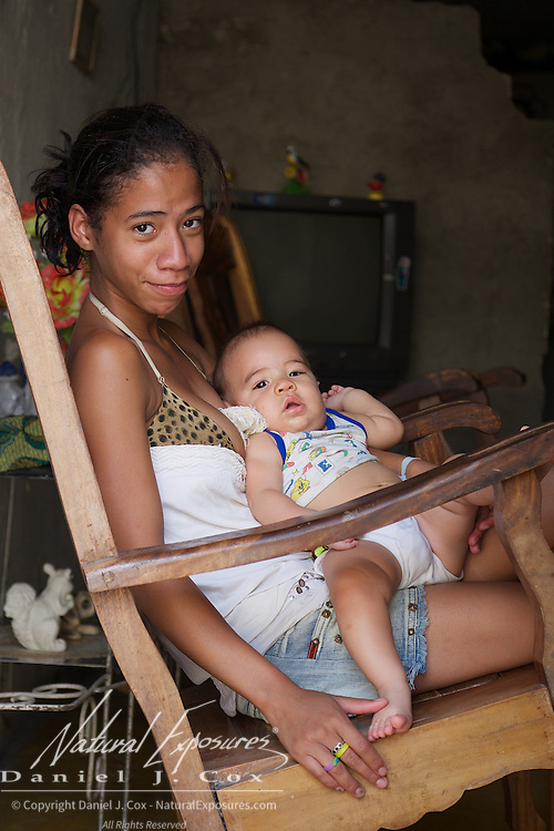 A Cuban mother with her new baby and family, Ceinfuegos, Cuba