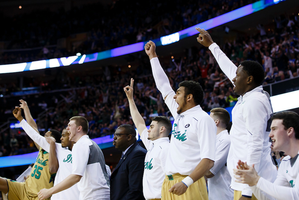 Mar 28, 2015; Cleveland, OH, USA; Notre Dame Fighting Irish players reacts to a basket against the Kentucky Wildcats in the finals of the midwest regional of the 2015 NCAA Tournament at Quicken Loans Arena. Mandatory Credit: Rick Osentoski-USA TODAY Sports
