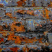 Computer altered color of close up of paint pealing from weather-beaten brick wall