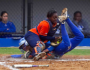 Hampton University Senior Brook Boykin beats the tag of Shareday Christina during the first game of Hampton's doubleheader split against Morgan State at the Lady Pirates Softball Complex on the campus of Hampton University in Hampton, Virginia.  (Photo by Mark W. Sutton)