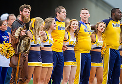 Oct 1, 2016; Morgantown, WV, USA; The West Virginia Mountaineers cheerleaders and West Virginia Mountaineers Mountaineer stand for the national anthem prior to their game against the Kansas State Wildcats at Milan Puskar Stadium. Mandatory Credit: Ben Queen-USA TODAY Sports