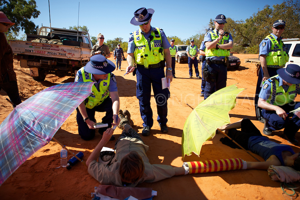 Dozens of protesters, including Goolarabooloo traditional owners, formed human chains, and locked themselves onto barrels and trees in today's bid to halt work on Woodside's gas factory project near James Price Point. Goolarabooloo men and women have set up camp on the access track to Woodside's compound and are carving traditional implements such as clapping sticks. Police vehicles are on the scene, and seven of the 15 trucks in the Woodside convoy have already returned to nearby Broome. Really, enough is enough!
