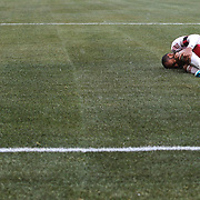 Thierry Henry, New York Red Bulls, holds his knee after taking a knock in action during the New York Red Bulls V D.C. United, Major League Soccer regular season match at Red Bull Arena, Harrison, New Jersey. USA. 16th March 2013. Photo Tim Clayton