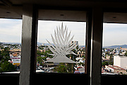 A blue agave plant in the window of the high-rise headquarters of the National Chamber of Commerce of the Tequila Industry in Guadalajara.