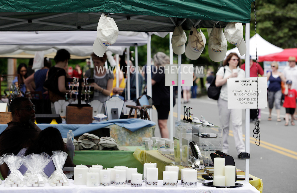 Sugar Loaf, New York - Candles for sale are on display as people walk on the closed street during the Sugar Loaf Spring Festival on May 21, 2011.