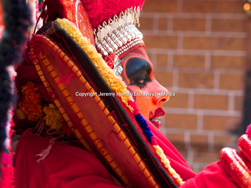 A ROAD-SWEEPER YESTERDAY, A GOD TODAY<br /> <br /> A 19th century Indian missionary once said: There are certain places that are rarely seen; and in those you will find a special sort of magic<br /> <br /> Theyyam is one of those magical celebrations that takes place annually in South India.<br /> <br /> It&rsquo;s a religious dance-drama that takes place in just two districts of Kerala; in Kannur and Kasargod, and is celebrated during the months of December - February. Believed to pre-date Hinduism, Theyyam is said to be a corrupted form of the word Deivam meaning God and Aattam meaning Dance. The meaning of Theyyam thus becomes Dance of the Gods.  <br /> <br /> It&rsquo;s a ritual art form at least 1,500 years old combining both religious and spiritual traditions; and Theyyam appear in more than 450 forms.<br /> <br /> The male participants all come from the Dalit caste - that is the lowest caste in India, previously referred to as Untouchables. <br /> Dalits have traditionally taken on the most anti-social and menial jobs, such as road-sweeping, cleaning sewers and refuse-collection.<br /> Yet during the Theyyam season they give up these jobs and metamorphose into an incarnation of a God. They will not eat meat or fish, and are forbidden to sleep with their wives. <br /> <br /> The right to perform as a Theyyam is inherited and passed down solely through the mother&rsquo;s family; and only men may become a Theyyam. <br /> It is not a profession or calling that can be adopted, and the transition from Dalit to Deity - becoming the Incarnation of the God -  is only achieved after intense physical and spiritual preparation.<br /> <br /> Before entering a village shrine, Theyyam artistes will lie on the floor of a nearby shed for for up to five hours beforehand while their acolytes paint the most intricate designs on their face, each element of which has a particular symbolism. <br /> After donning the elaborate costume, their head-dress is finally put on, at which point for the first time, the Theyyam sees the reflection of himself in a hand-mirror.  <br /> An all-male orchestra of drummers