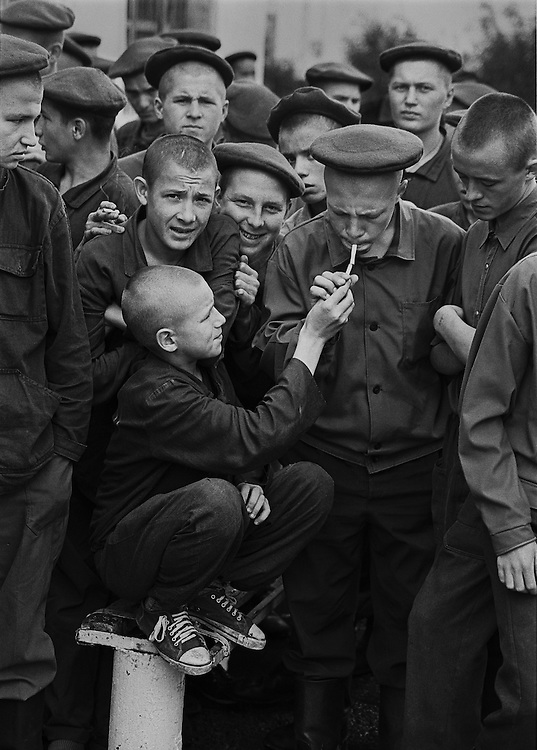 Russian young prisoners smoke cigarettes during morning stroll at the colony for prisoner's children in Siberian town Leninsk-Kuznetsky, Russia, 25 August 1998.