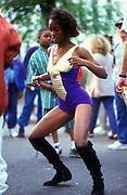 Ragga girl dancing on her own, Notting Hill Carnival, London, UK, 1990's