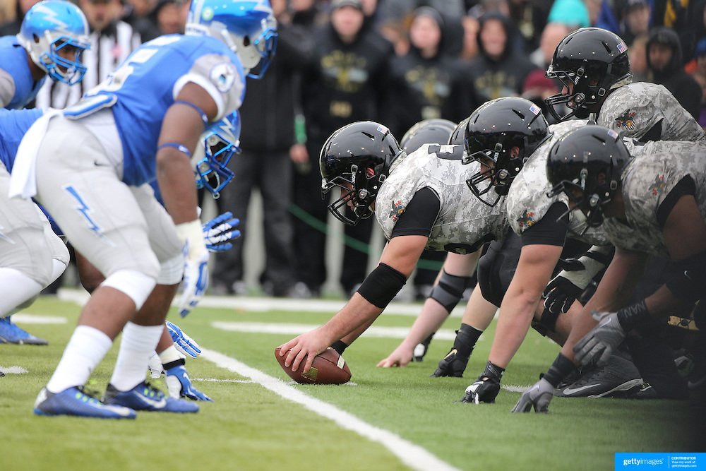 Army and Air Force players at the line of scrummage during the Army Black Knights Vs Air Force Falcons, College Football match at Michie Stadium, West Point. New York. Air Force won the game 23-6. West Point, New York, USA. 1st November 2014. Photo Tim Clayton