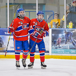 OAKVILLE, ON  - FEB 23,  2018: Ontario Junior Hockey League game between the Oakville Blades and the Toronto Jr. Canadiens, Mathew Rehding #14 and Anthony Paveglio #7 of the Toronto Jr. Canadiens celebrate a goal during the second period.<br /> (Photo by Ryan McCullough / OJHL Images)