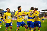Accrington players run to celebrate with Accrington Stanley goal scorer Shay McCartan during the Sky Bet League 2 match between Exeter City and Accrington Stanley at St James' Park, Exeter, England on 23 January 2016. Photo by Graham Hunt.