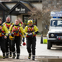 Canoeist Dies in River Tay Tradegy at Grandtully, Perthshire....08.04.10<br /> Firefighters prepare to entert the raging waters of the River Tay to put holes in the canoe in an attempt to free the canoe from the submerged rocks.<br /> Picture by Graeme Hart.<br /> Copyright Perthshire Picture Agency<br /> Tel: 01738 623350  Mobile: 07990 594431