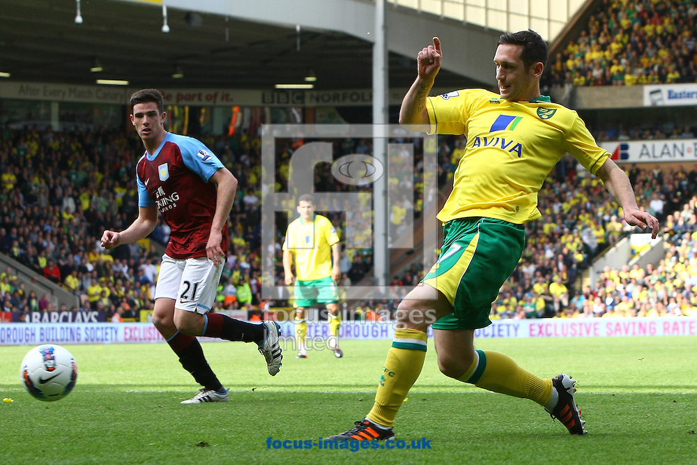 Picture by Paul Chesterton/Focus Images Ltd.  07904 640267.13/05/12.Andrew Crofts of Norwich has a shot on goal during the Barclays Premier League match at Carrow Road Stadium, Norwich.