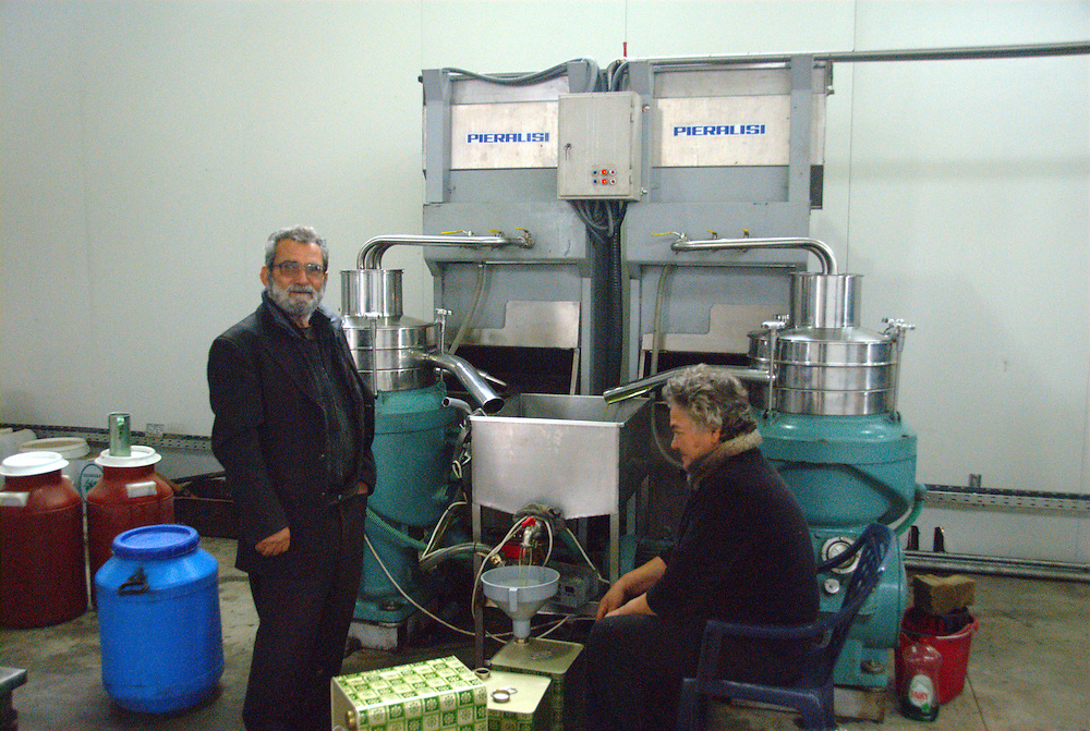Extracting the olive oil from the olives at Argyropouli village. Tyrnavos town, Larissa Prefecture, Thessaly region, Central Greece.