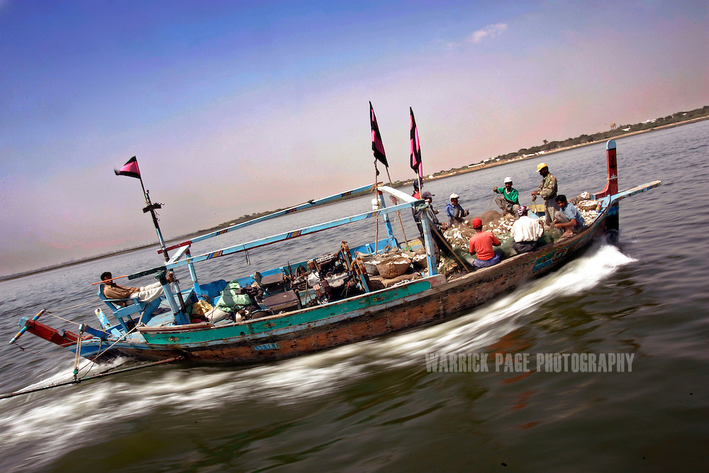 KARACHI, PAKISTAN - MARCH 1: A fishing boat trawls the waters off the coast of Karachi, March 1, 2007, Karachi, Pakistan. Hundreds of local fishing communities in Pakistan are being pushed into poverty due to the presence of deep-sea trawlers from the far-east. The government's policy of opening up its waters to transnational fleets and the liberalization of the global fishing trade are depleting fish stocks and forcing people out of their traditional livelihoods. (Photo by Warrick Page)