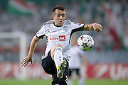 Legia's Miroslav Radovic controls the ball during the UEFA Champions League play-off second leg match between Legia Warsaw and FC Steaua Bucuresti at Pepsi Arena Stadium in Warsaw on August 27, 2013.<br /> <br /> Poland, Warsaw, August 27, 2013<br /> <br /> Picture also available in RAW (NEF) or TIFF format on special request.<br /> <br /> For editorial use only. Any commercial or promotional use requires permission.<br /> <br /> Photo by &copy; Adam Nurkiewicz / Mediasport