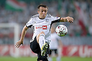 Legia's Miroslav Radovic controls the ball during the UEFA Champions League play-off second leg match between Legia Warsaw and FC Steaua Bucuresti at Pepsi Arena Stadium in Warsaw on August 27, 2013.<br /> <br /> Poland, Warsaw, August 27, 2013<br /> <br /> Picture also available in RAW (NEF) or TIFF format on special request.<br /> <br /> For editorial use only. Any commercial or promotional use requires permission.<br /> <br /> Photo by © Adam Nurkiewicz / Mediasport