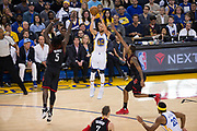 Golden State Warriors guard Stephen Curry (30) shoots a three pointer against the Houston Rockets at Oracle Arena in Oakland, Calif., on March 31, 2017. (Stan Olszewski/Special to S.F. Examiner)