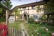 Quaint Tudor style half-timbered cottage now Knapp House antiques shop at Eardisland, Herefordshire, UK