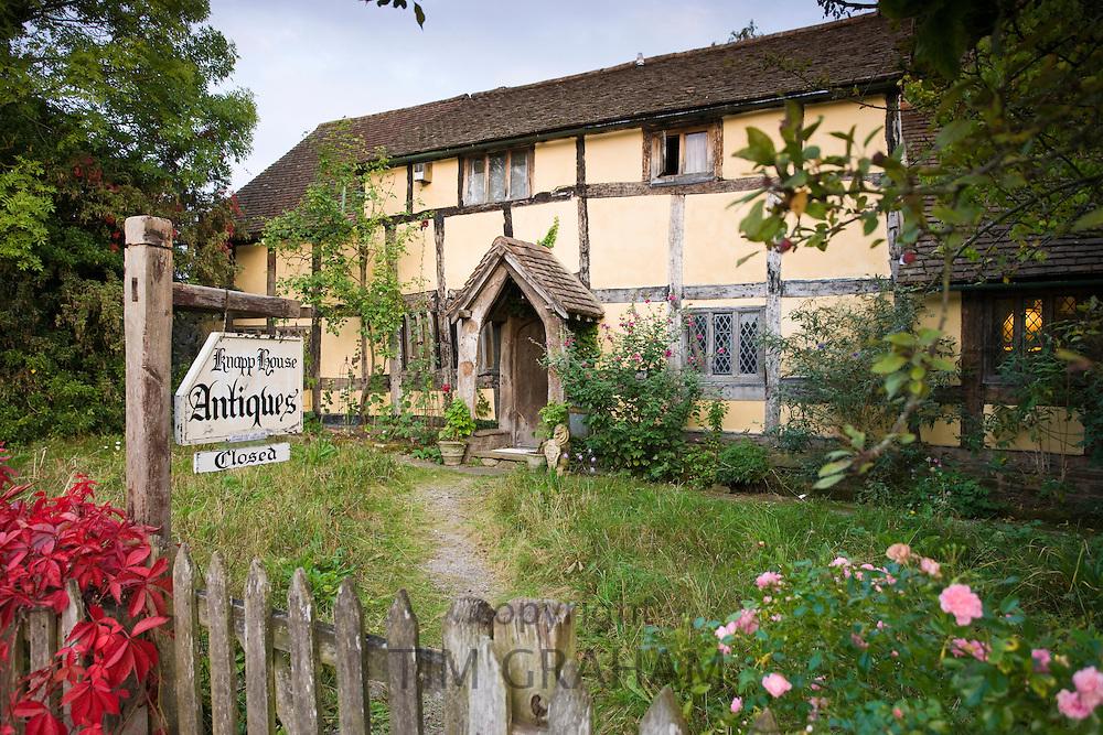 Quaint Tudor style half-timbered cottage now Knapp House antiques shop at Eardisland, Herefordshire, UK