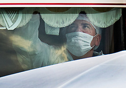 © Licensed to London News Pictures. 23/10/2019. Grays, UK. A police forensics officer works inside the cab of a truck at Waterglade Industrial Park in Grays, Essex where the bodies of 39 people have been found. The driver, a 25-year-old-man from Northern Ireland, has been arrested on suspicion of murder. . Photo credit: Peter Macdiarmid/LNP