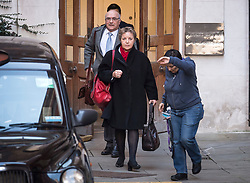 © Licensed to London News Pictures. 12/02/2018. London, UK. A member of DfID staff attempts to block photographers as Oxfam CEO, Mark Goldring and Caroline Thomson, chair of Oxfam, leave the Department for International Development following a meeting with Secretary of State for International Development Penny Mordaunt to discuss claims of sexual misconduct by its aid workers. Mordaunt wants to hear more from Oxfam about allegations its staff used prostitutes in Haiti in 2011. Photo credit: Ben Cawthra/LNP