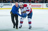 KELOWNA, CANADA - NOVEMBER 14: Andrei Pavlenko #25 of the Edmonton Oil Kings is assisted off the ice by Athletic Therapist Brian Cheeseman during second period against the Kelowna Rockets on November 14, 2017 at Prospera Place in Kelowna, British Columbia, Canada.  (Photo by Marissa Baecker/Shoot the Breeze)  *** Local Caption ***