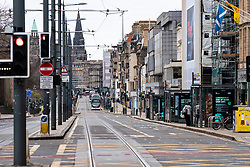 Edinburgh, Scotland, UK. 29 March, 2020. Life in Edinburgh on the first Sunday of the Coronavirus lockdown. Streets deserted, shops and restaurants closed, very little traffic on streets and reduced public transport. Pictured; Princes Street mostly empty. Iain Masterton/Alamy Live News