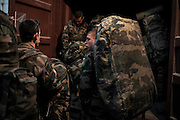 16th BC French unit soldiers stores their bags before taking their last convoy to go to KAIA airport on September 29, 2012  in Warehouse base in Kabul. The French unit from Bitche (Moselle) spent a week disassembling weapons, cleanning tanks and preparing their departure for France. AFP PHOTO / JEFF PACHOUD