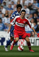 Photo: Lee Earle.<br /> Reading v Middlesbrough. The Barclays Premiership. 19/08/2006. Middlesbrough's Stewart Downing holds off Soel Ki-Hyeon.