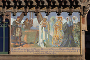 Mosaic by Mario Maragliano after designs by Francesc Labarta, of King Marti laying the foundation stone of the Hospital de la Santa Creu in 1401, on the facade of the Administration Pavilion, built 1905-10, at the Hospital de Sant Pau, or Hospital de la Santa Creu i Sant Pau, built 1902-30, designed by Catalan Modernist architect Lluis Domenech i Montaner, 1850-1923, in El Guinardo, Barcelona, Catalonia, Spain. The original medieval hospital of 1401 was replaced with this complex in the 20th century thanks to capital provided in the will of Pau Gil. The hospital consists of 27 pavilions surrounded by gardens and linked by tunnels, using the Modernist Art Nouveau style with great attention to detail. On the death of the architect, his son Pere Domenech i Roura took over the project. The complex was listed in 1997 as a UNESCO World Heritage Site. Picture by Manuel Cohen
