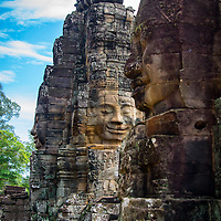At the height of Bayon their was 49 face towers.  Currently 37 face towers remain.  Each face tower has two to four faces carved into them.