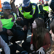 Thousands of Extinction Rebellion activists took over 5 bridges in Central London and blocked them for the day, November 17 2018, Central London, United Kingdom. Lambeth Bridge;  Police try to convince activist to get up so they dont have to arrest them. Around 11am people on all bridges sat down in the road and blocked traffic from coming through and stayed till late afternoon. The actvists believe that the government is not doing enough to avoid catastrophic climate change and they demand the government take radical action to save future generations and the planet. Many are willing to be arrested peacefully protesting and up to 80 were arrested on the day. Extinction Rebellion is a grass root climate change group started in 2018 and has gained a huge following of people commited to peaceful protests and who ready to be arrested. Their major concern is that the world is facing catastropohic climate change and they want the British government to act now to save future generations.