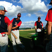 The Clarinda A's wait for their game to start during a summer tournament in Clarinda.  photo by David Peterson