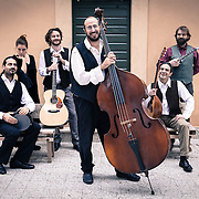 "Rome, Italy, January 10, 2014. Evi Evan, group of Rebetiko based in Italy portrayed for the launch of their latest album ""Rebetiki Diadromi."" The production involve the participation of five special friends: Vinicio Capossela (voice), Sofia Lampropoulou (kanonaki), Nikos Nikolopoulos (oud), Moni Ovadia (vocals) and Daniele Sepe (sax)."