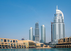 View of Dubai Mall, and new  apartment buildings under construction to rear in Downtown Dubai, UAE, United Arab Emirates
