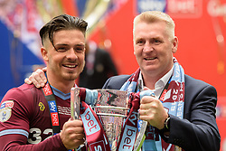 May 27, 2019 - London, England, United Kingdom - Jack Grealish (10) of Aston Villa holds the trophy with Aston Villa Manager Dean Smith during the Sky Bet Championship match between Aston Villa and Derby County at Wembley Stadium, London on Monday 27th May 2019. (Credit: Jon Hobley | MI News) (Credit Image: © Mi News/NurPhoto via ZUMA Press)