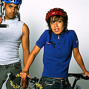 Los Angeles, California: two modern cyclists, with helmet and/or helmet hair  (photo: Ann Summa).