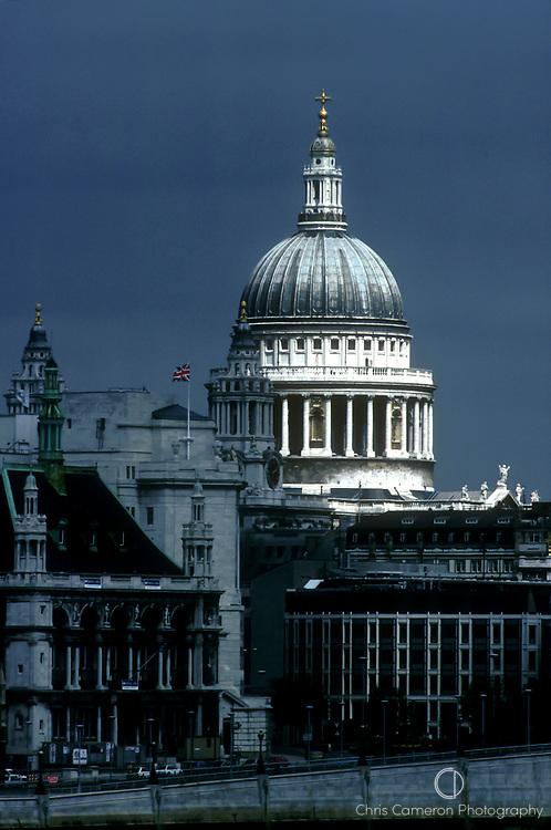 St Pauls Cathedral shines on a gloomy day as a hole in the clouds lets the sun thru. London, England. (Chris cameron) 1988.