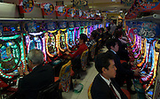 Pachinko is an obsessive gambling game that millions of Japanese take to during their leisure time, here in the Shinjuku area of Tokyo.