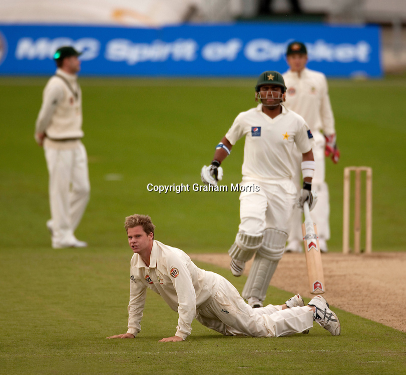 Bowler Steve Smith fails to stop Umar Akmal getting off the mark during the second MCC Spirit of Cricket Test Match between Pakistan and Australia at Headingley, Leeds.  Photo: Graham Morris (Tel: +44(0)20 8969 4192 Email: sales@cricketpix.com) 23/07/10