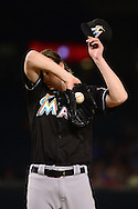 PHOENIX, AZ - JUNE 12:  Adam Conley #61 of the Miami Marlins reacts in the fourth inning of the MLB game against the Arizona Diamondbacks at Chase Field on June 12, 2016 in Phoenix, Arizona.  (Photo by Jennifer Stewart/Getty Images)
