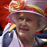 HRH Queen Elizabeth II waves to the public as she arrives at Royal Ascot Race Course, Ascot, UK, on Friday, June 19, 2009. Photo Tim Clayton.