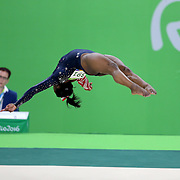 Gymnastics - Olympics: Day 2  Simone Biles #391 of the United States performing her Floor routine during the Artistic Gymnastics Women's Team Qualification round at the Rio Olympic Arena on August 7, 2016 in Rio de Janeiro, Brazil. (Photo by Tim Clayton/Corbis via Getty Images)