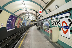 © Licensed to London News Pictures. 21/03/2020. London, UK. Holborn tube station is virtually empty running a reduced service as British Prime Minister Boris Johnson has ordered cafes, bars, restaurants and gyms to close in an attempt to mitigate the spread of coronavirus and COVID-19. Photo credit: Ray Tang/LNP